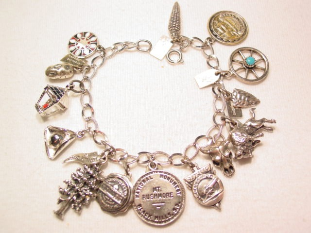 Sterling Charm Bracelet with 14 Charms