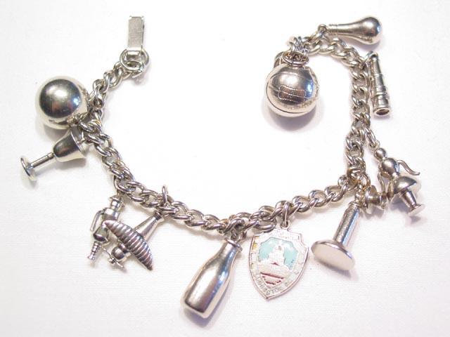 Silvertone 11 Charms Charm Bracelet