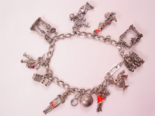 Old Charm of a Charmer Bracelet - Some Sterling