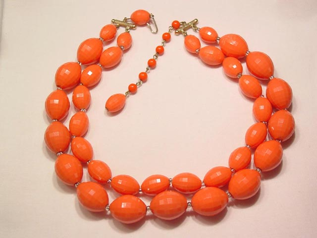 Double Strand Coral Colored Plastic Necklace
