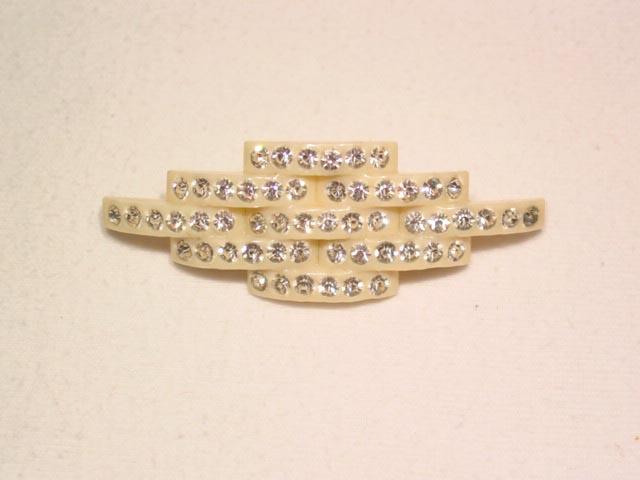 Art Deco Style White Plastic and Rhinestone Pin
