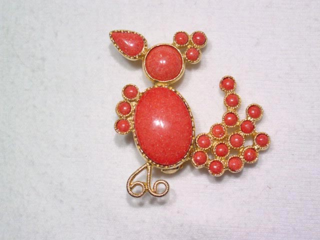 Coral Colored Goony Bird Pin with Tremblant Tail