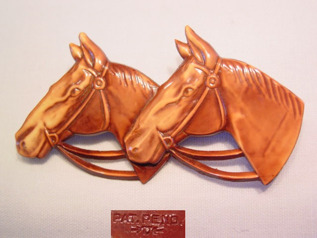 Brown Plastic Double-Headed Horse Pin