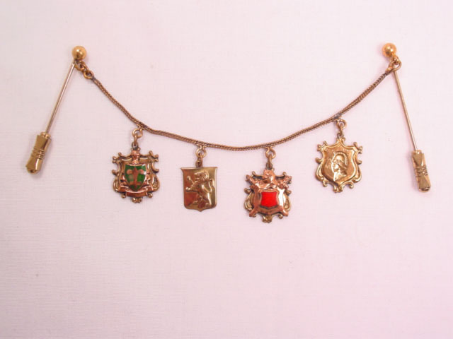 Double Stickpins with 4 Shields on a Chain