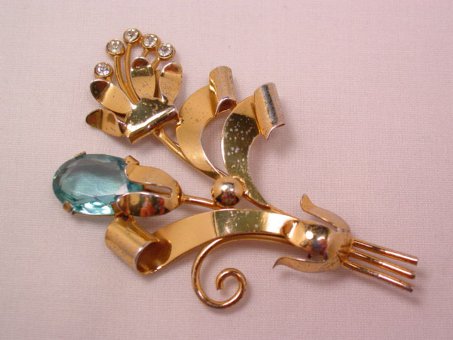 Beautiful Gold-Finished Sterling Flower Pin with Aqua Rhinestone